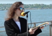 Lady recites poetry in celebration of Walt Whitman's 200th Birthday alongside New York Harbor.